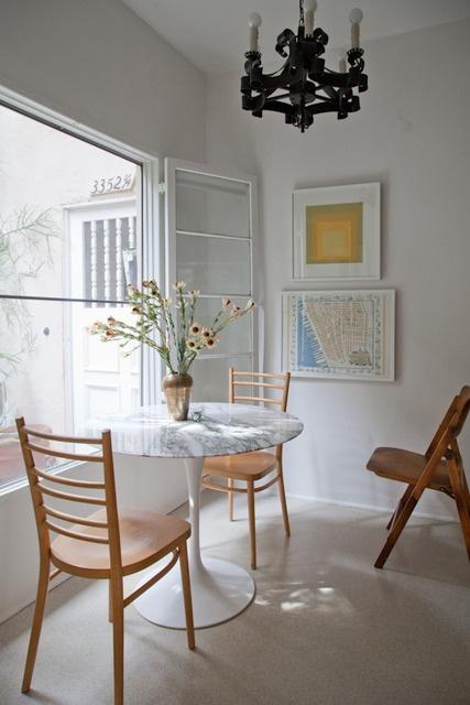 eero saarinen tulip table (with paris cafe chairs...?).