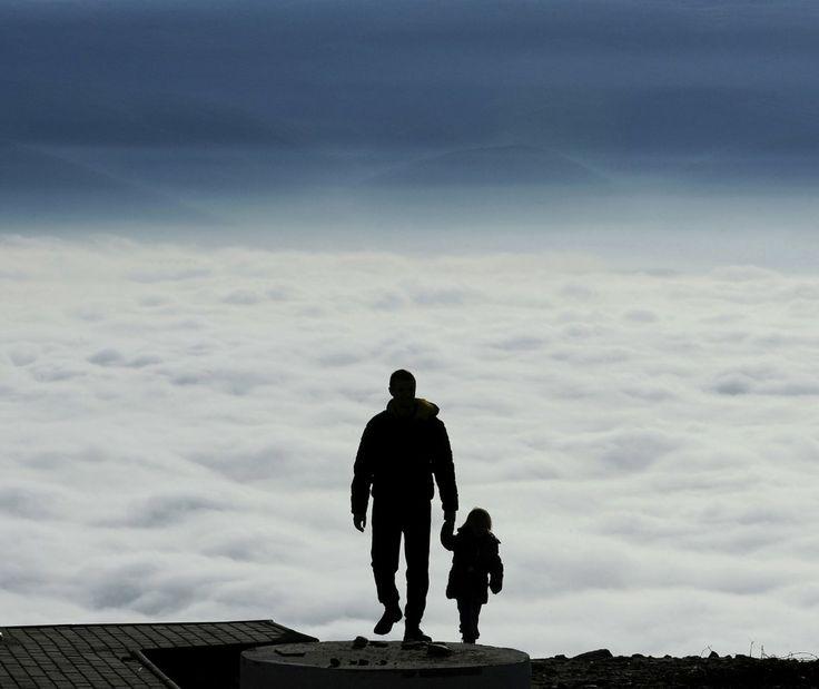 A man wiht a child walks towards the top of Vodno Mountain, Skopje, Macedonia. Photo: Boris Grdanoski/AP