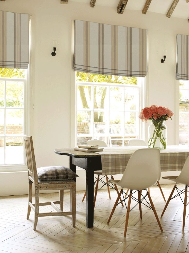 Create this country look even in a modern kitchen. Simply add some wooden texture, Lulu Stripe Natural roman blind and remember to add some fresh flowers. Shop the window look.
