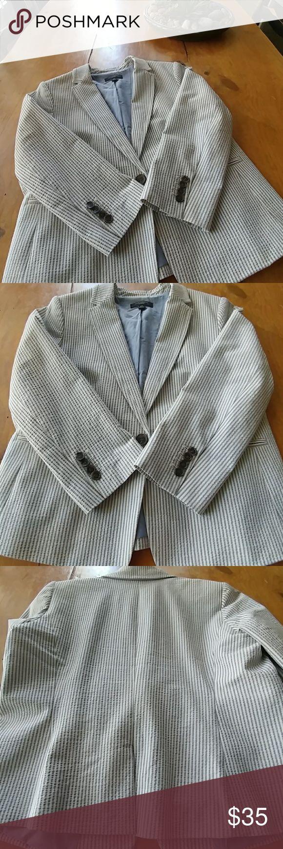 Ann Taylor Seersucker Blazer Blue & Cream Seersucker Blazer labeled 12P. Definitely runs SMALL more like a small 10P. Worn 1 maybe 2 times. Comfortable because if it's 95% Cotton/5% Spandex Fabric. Ann Taylor Jackets & Coats Blazers