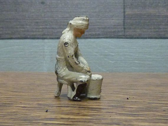 """on Etsy... """"Britains Lead Indian Soldier   This old pre wear lead figure of a indian man sat on a stool washing is in good condition though does have some paint loss from play. I think this he is from the Indian Army as wearing a white uniform with brown boots.""""    (Milkmaid by Taylor & Barrett, prewar)"""