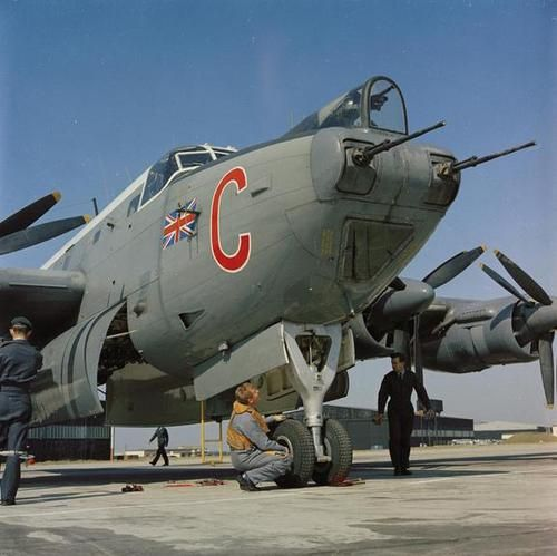 Sergeant Michael 'Jacko' Jackson, air engineer of Avro Shackleton MR.3 XF707 of No 206 Squadron, checks the wheel bay and undercarriage of his aircraft pre-flight at RAF St Mawgan, Cornwall. Just visible in the aircrafts capacious bomb bay are depth charges and eight and one half pound break up bombs. The marshaller's bats are seen tucked under the nose wheel. Photo by David Lamberson