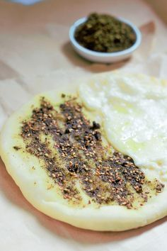 Zaatar Manakeesh with Cheese Recipe - Manakish Cheese Zaatar. A flavorful Arabic flat bread recipe made with the yummy goodness of both the Zaatar and Cheese.