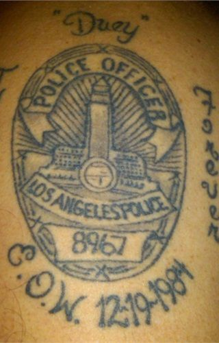 """This officer's tattoo honors his fallen twin brother Duane """"Duey"""" Johnson, an LAPD officer who was killed in a 1984 gunfight in Chinatown. - www.policemag.com - #police"""