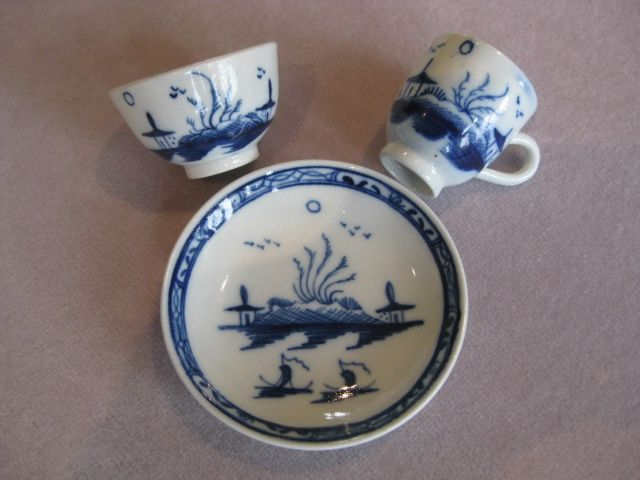 A Caughley miniature trio painted with the Island pattern.  s mark   Circa 1775  Width of saucer   2 3/4""