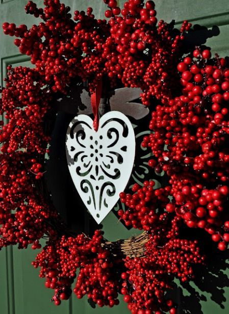 On of our favorite craft bloggers, Laura, just showed me this wonderful project she created to celebrate Valentine's Day. I love the simplicity of this Valentine's wreath. Laura was able to get this wreath for a steal. She snagged it at Michaels when they were having a 70% off sale.