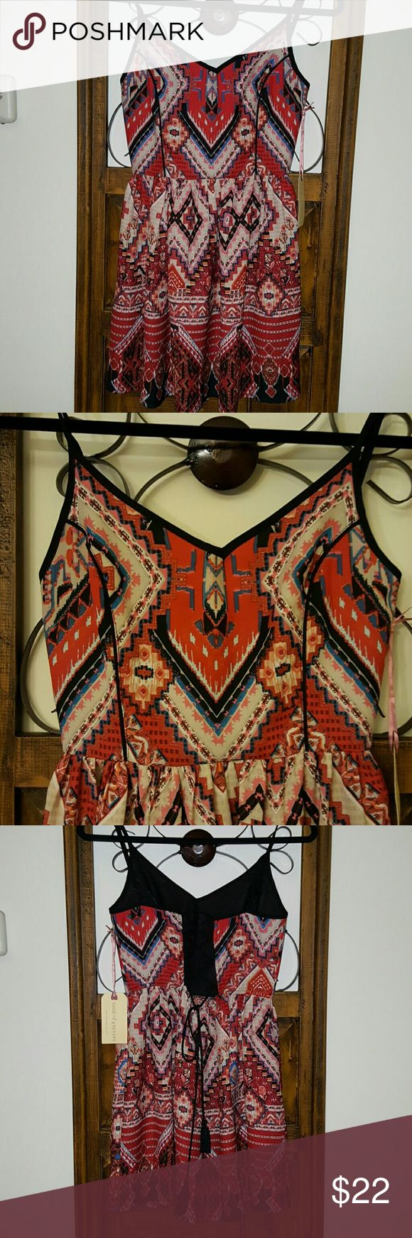 Adorable little aztec mini dress NWT Aztec print, beautiful design and colors with corset style back. Band of Gypsies Dresses Mini