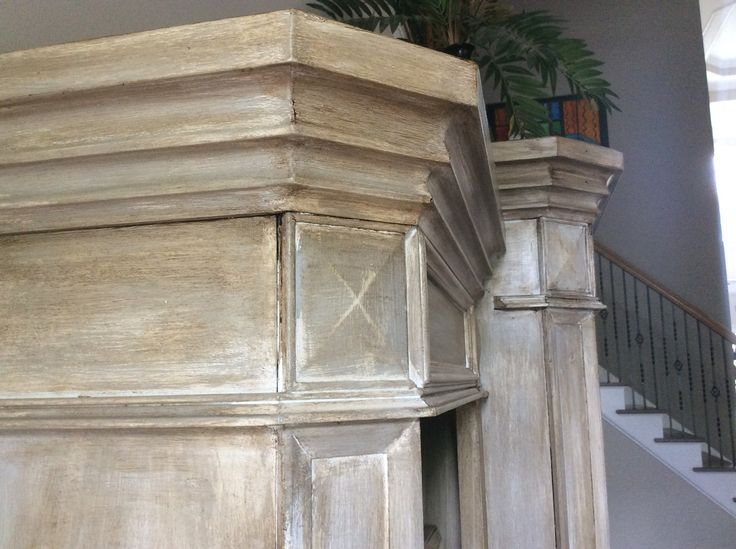 """Chalk paint and wax applied to honey maple colored entertainment center. One coat of Rust oleum """"Linen White"""" Chalked paint with a wash of Rust oleum """"Aged Gray."""" Sealed with Annie Sloan clear wax then I brushed and ragged on Annie Sloan dark wax."""