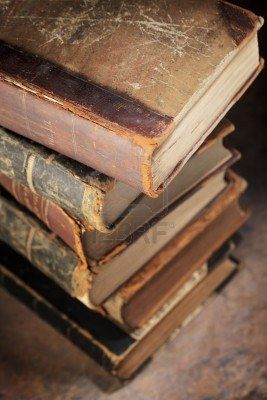 10422083-a-stack-of-old-worn-and-tattered-books-short-depth-of-field.jpg (267×400)