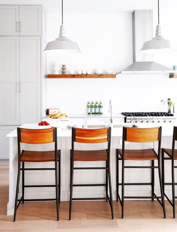 white kitchen + wood shelf and stools