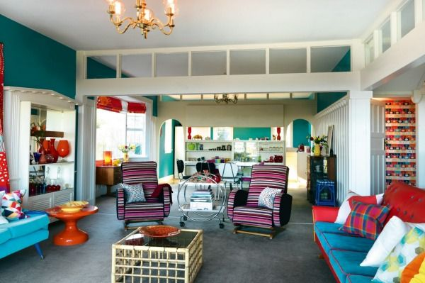 Lou Barker isn't afraid to mix colours, styles and patterns, as seen in her living room, with its array of revamped retro furniture.