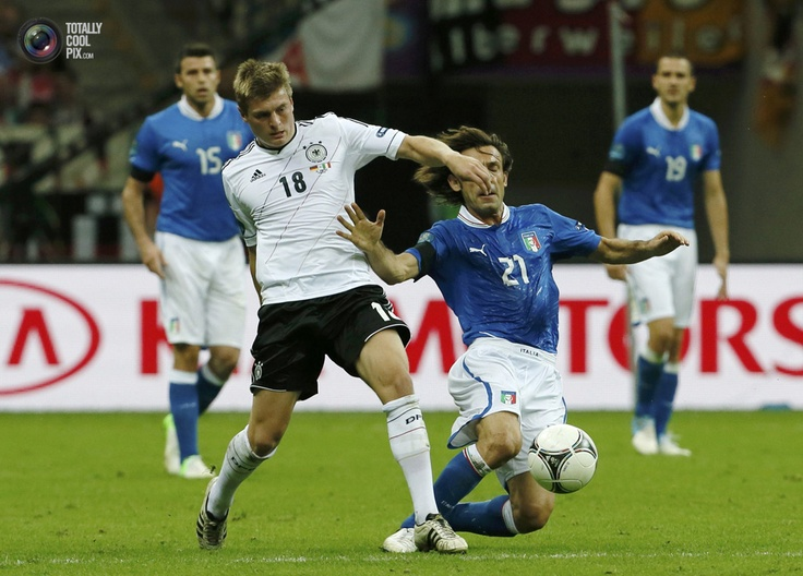 Germany's Kroos challenges Italy's Pirlo during their Euro 2012 semi-final soccer match at National Stadium in Warsaw. TONY GENTILE/REUTERS