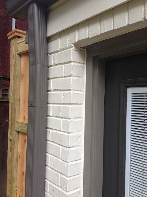 Painted White Brick House With Dark Trim
