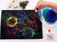 FireworksPainting2 Mix glue in paint. Use net scrubber dip in paint, press on paper, sprinkle with glitter