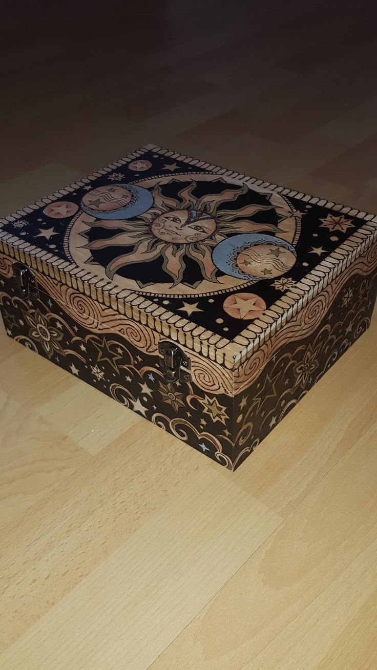 Woodbox with Sun and Moon motifs