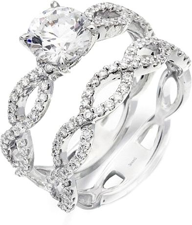 Simon G Twist Shank Diamond Engagement Ring Setting  : This diamond engagement ring by Simon G has a unique open twist design with pave set diamonds going almost all the way around the band.