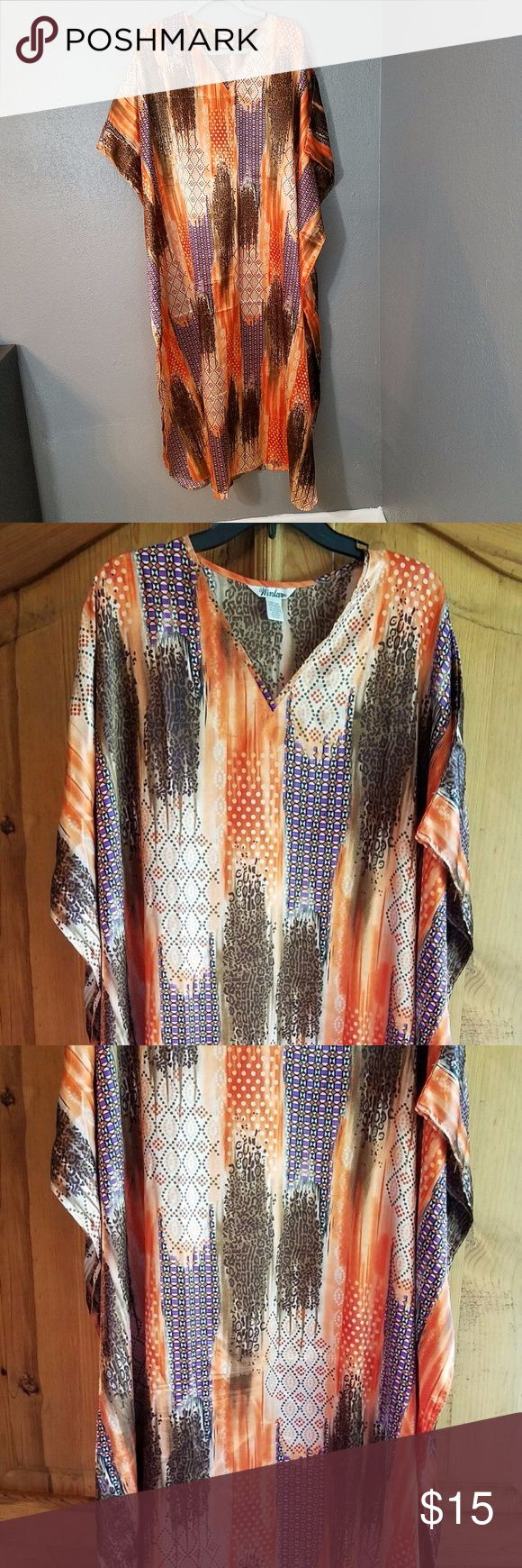 "Winlar Caftan O/S one size orange brown animal WINLAR CAFTAN Muumuu dress. It is orange and browns. Has several different patterns, please take a look at the pictures.  Some animal print, dots, and more.  It is One size fits most. In gently used good condition. No rips or stains. This is one of three that I have listed. Please take a look at my store.  About 42"" shoulder to shoulder.  Neck to hem is about 52"".  There is a slit on both sides at the bottom of about 18"".   There is a seam down…"