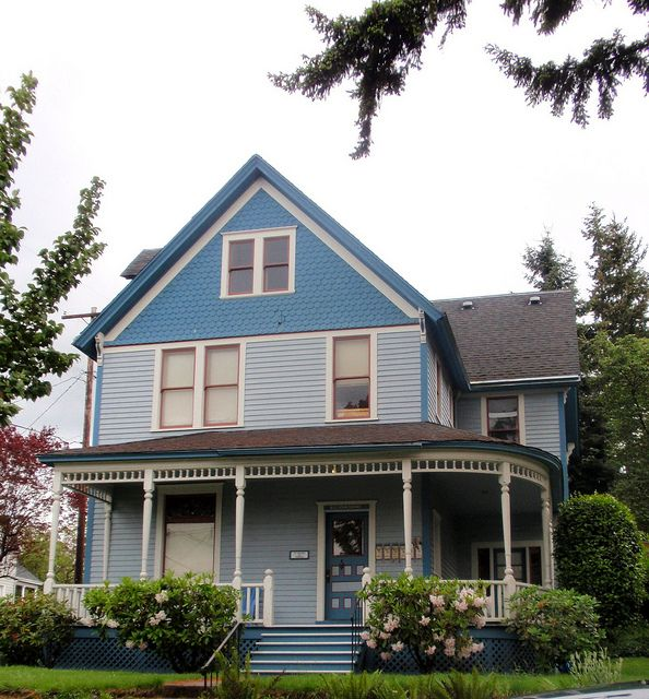 Blue Victorian Farm House With Wraparound Porch