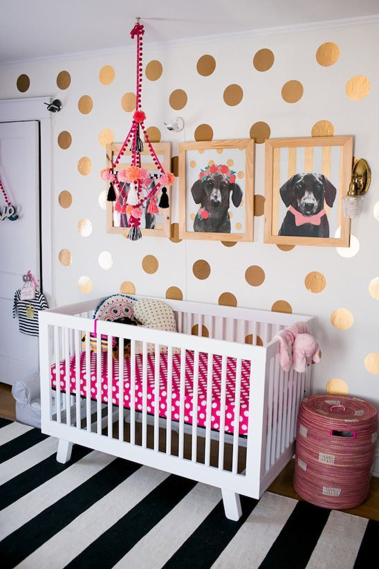 Fun, colorful nursery in teal, pink, black, and gold