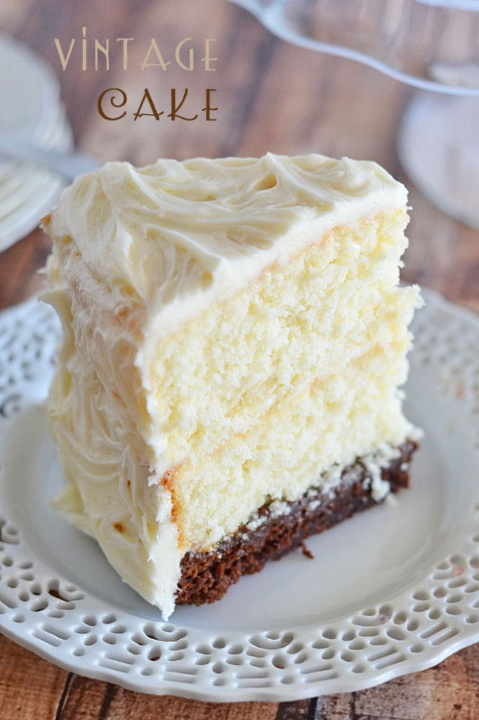 This Vintage Cake combines two layers of white cake, with a surprise brownie layer soaked in a decadent chocolate sauce. And the cream cheese frosting takes it right over the top! | Kitchen Meets Girl