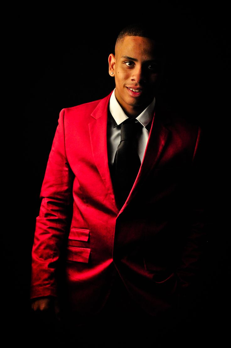 Nathan is styling in his Red suit, white shirt and black tie From Markam Cape Town on his Matric Ball aka Prom