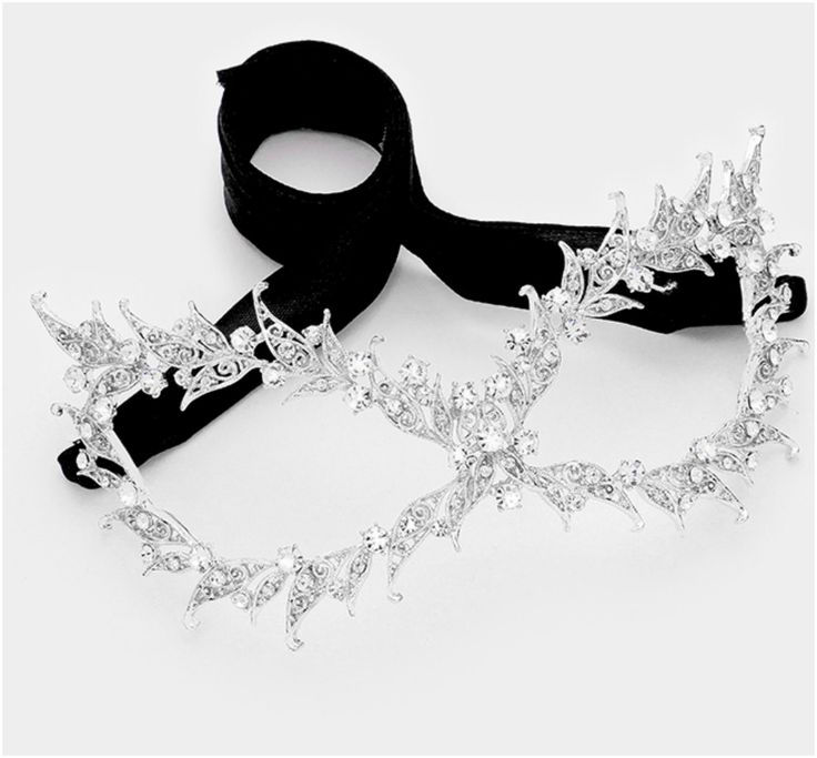 Pasha Filigree Cat Eye Crystal Silver Masquerade Mask. Description: This Filigree Vine Cat Eye Masquerade Mask is created with best quality sparkling Crystal and Black Ribbon Tie. This gorgeous piece