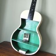 Junk Guitar turned wall shelf - http://craftideas.bitchinrants.com/junk-guitar-turned-wall-shelf/