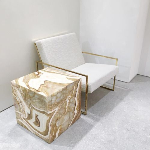 Oh man, what we would do for a gold marble cube side table.