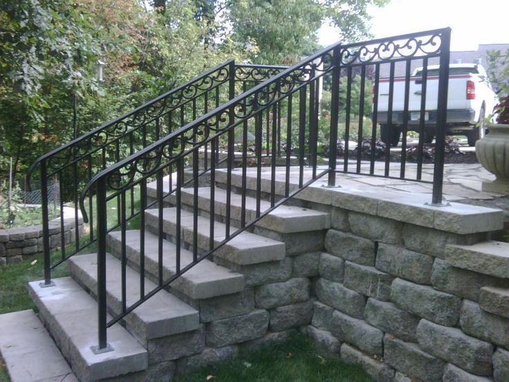 Railing stairs exterior fence iron work exterior for Exterior stone stairs design