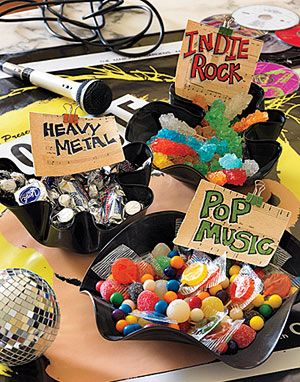 """Music Munchies - Create candy bowls themed by different music styles: """"Indie Rock"""" rock-candy sticks; """"Heavy Metal"""" silver-wrapped chocolates; and """"Pop Music"""" lollipops and Pop Rocks."""