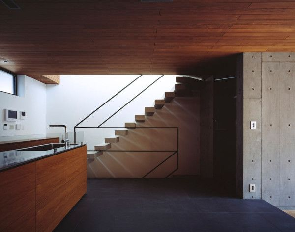 a house built with exposed concrete to reduce costs