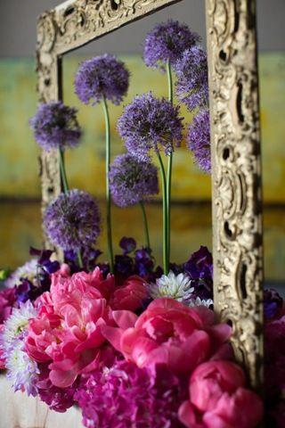 floral art design - flower arrangement art installation with allium, dahlias, peonies, sweet peas, and hydrangea.