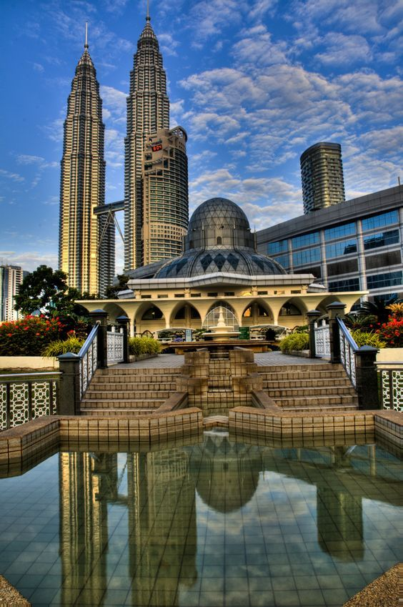 KLCC Mosque, is a mosque located in the Kuala Lumpur City Centre, Kuala Lumpur, Malaysia. The mosque is situated near the Suria KLCC shopping centre and the Petronas Twin Towers, the tallest twin towers in the world. The mosque is an architectural landmark of Islam in a rapidly developing area in the capital city, Kuala Lumpur.