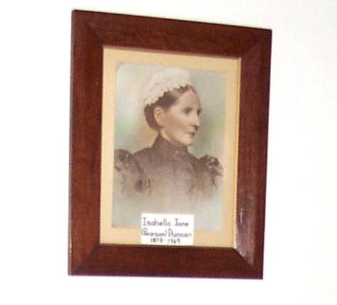 A framed tinted photo of Isabella Jane Duncan (nee Pearson).
