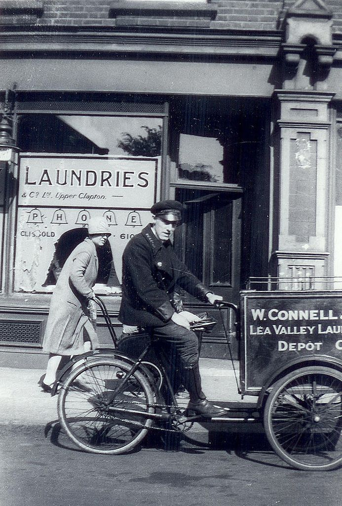 1933 Outside Connells Laundry, Hackney, London. We love looking back at old photos and imagining what the world was like before we set foot on it! Follow our Pinterest page so you can catch updates on the diverse and interesting selection of photographs that we have put together in order to give you an idea of the area which you're curious about from a real perspective! #hackney #london #blackandwhite
