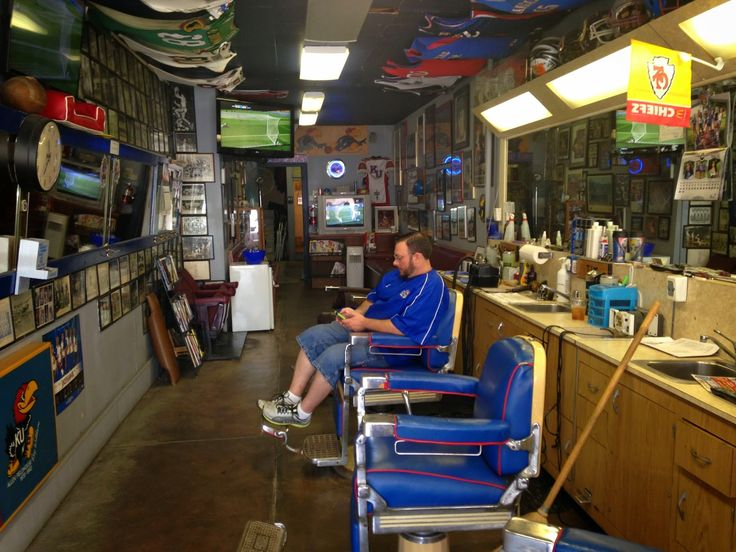 """Rex's Stadium Barber Shop, 1033 Massachusetts Ave, Lawrence, Kansas. It's been some variant of """"Stadium Barber Shop"""" since 1923. Present owner Rex Porter, formerly with Downtown Barber Shop, bought this place in 2004 from RC Pewtress, proprietor since 1987. Rex has kept it as a Kansas Jayhawks sports shrine."""