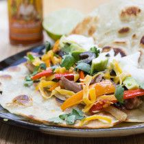 Grilled Shredded Pork Tacos - Made using the Napoleon Rib Roast Rack and Pan! a great dish for a family fiesta.
