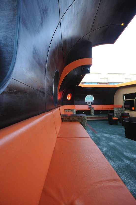 Detail of curved vinyl clad wall and seating