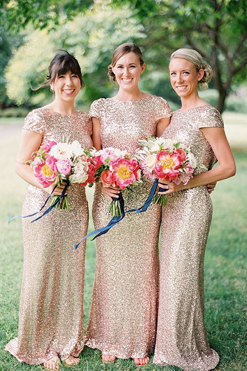 Sequined @badgleymischka bridesmaid dresses (and pretty pink bouquets!) | @cocotranphoto | Brides.com
