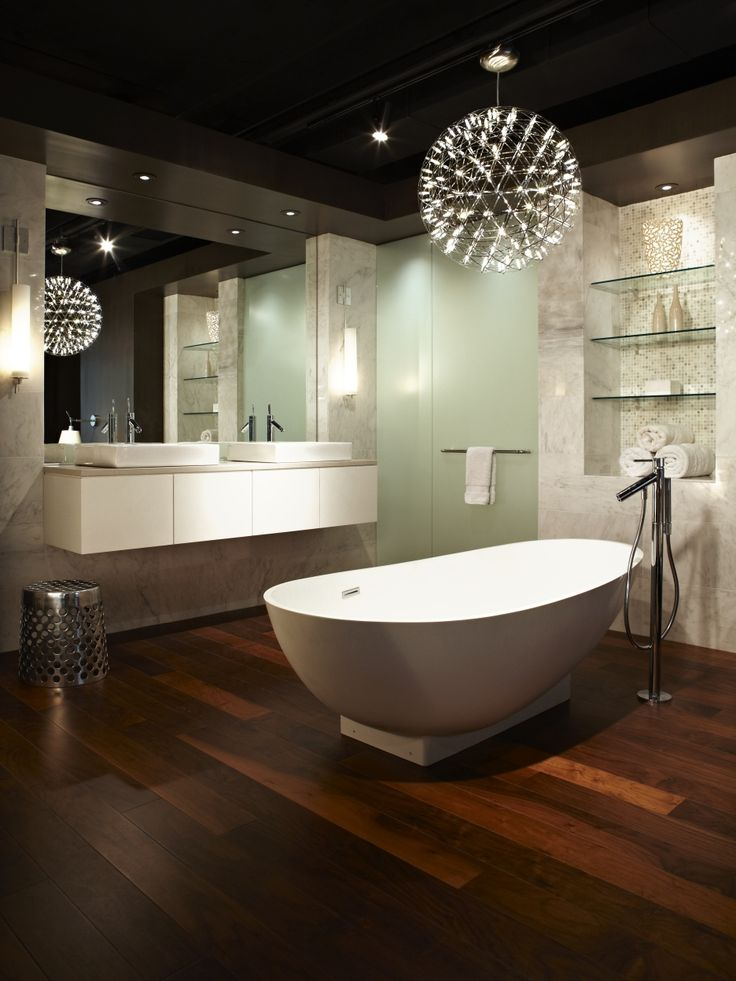 in a modern bathroom where there is a tub area you can also use a modern chandelier if so you are not only lighting up the tub area but also creating a