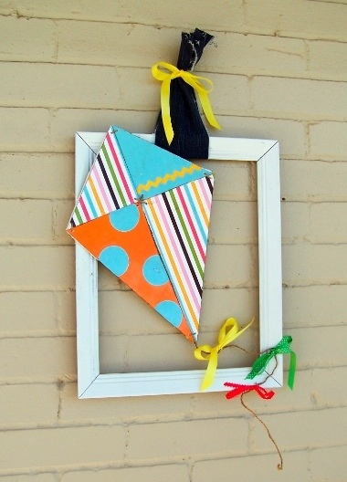 Kite wreath with old picture frame.