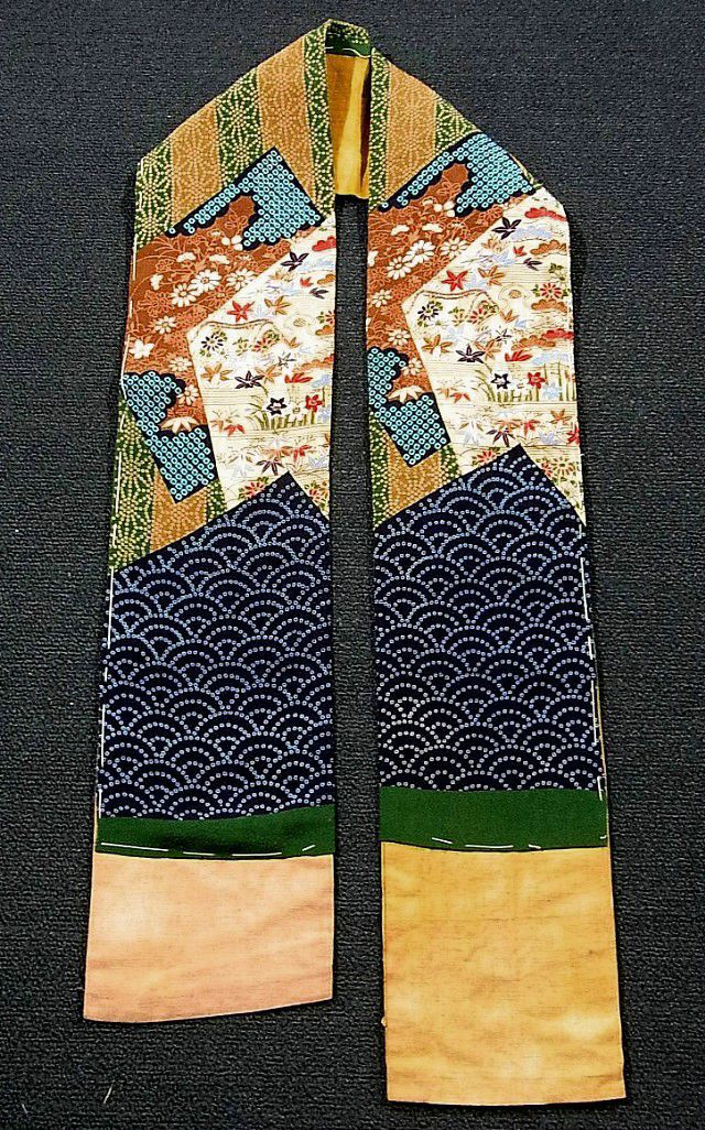 This is a vintage han'eri, lapel for kimono juban(undergarment). It has classical dyed pattern with fine embroidery accents in places. Textile is silk, but it is attached on thick cotton fabric.