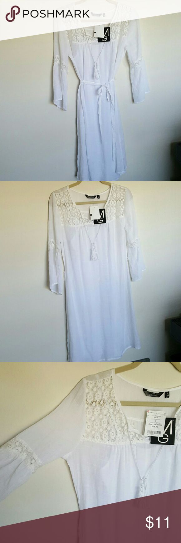 NWT white festival dress Lace details, tie around waist or can be worn without. Comes with white slip underneath. Perfect for the beach or festivals! Dresses Midi