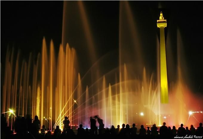"""Monas or National Monument is the 132-meter tower in the centre of Merdeka Square, Central Jakarta. Symbolizing the fight for Indonesia, gold-plated flame on top means burning fighting spirit.  Designed based on masculinity and femininity """"lingga"""" and """"yoni"""" principle, the monument can also be interpreted as """"alu"""" and """"lesung"""", traditional rice pestle. Inside there is a museum."""
