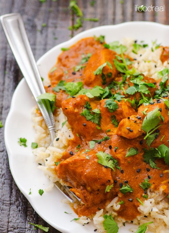 closeup-crock-pot-butter-chicken-recipe:  3 - 3.5 lbs chicken breasts, skinless & boneless,  4 garlic cloves,  2 medium onions,  1/2 inch ginger root,   2 tsp garam masala,  1 tsp curry powder , 1/2 tsp chili powder,  1/3 tsp salt,  1/2 tsp freshly ground black pepper, 6 oz can tomato paste,  14 oz can coconut milk, light,  1/4 cup whole wheat flour (optional)  1/4 cup cilantro/scallions, chopped (for garnish)