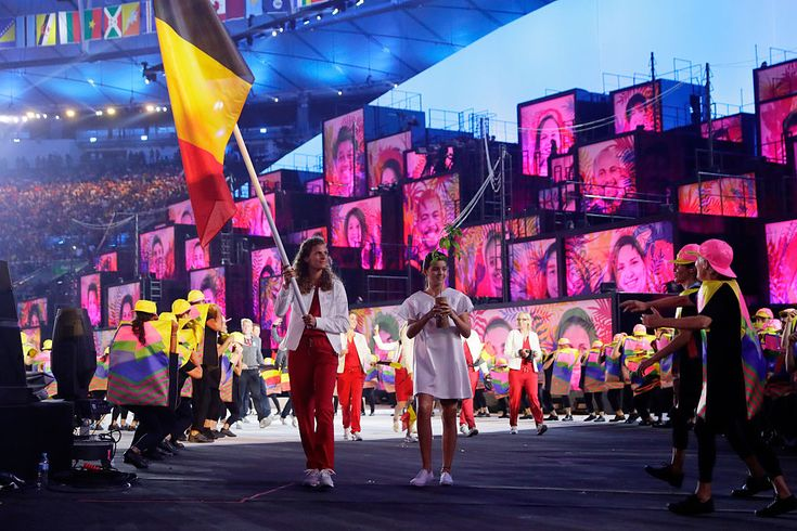 RIO DE JANEIRO, BRAZIL - AUGUST 05: Flag bearer Olivia Borlee of Belgium leads her team during the Opening Ceremony of the Rio 2016…