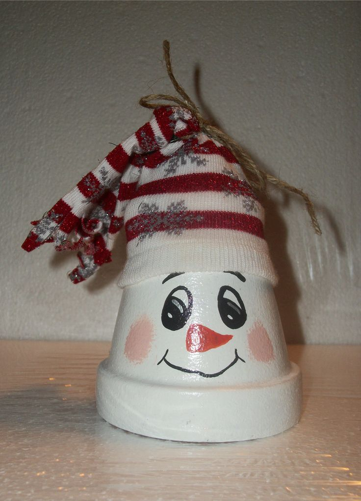 Small clay pot snowman topped with Christmas sock