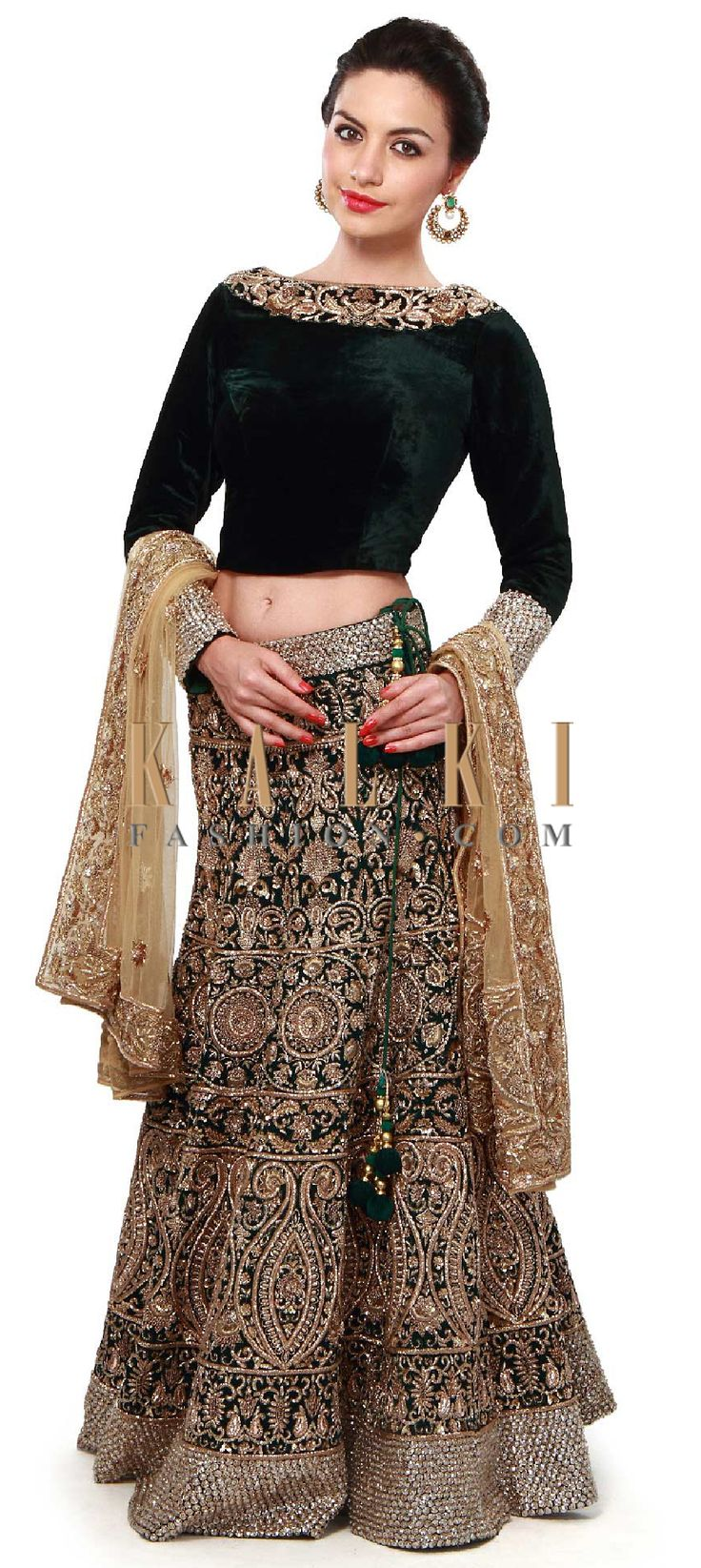 Buy Online from the link below. We ship worldwide (Free Shipping over US$100). Product SKU - 259035. Product Price - $2,289.00. Product link - http://www.kalkifashion.com/dark-green-lehenga-adorn-in-stone-and-zardosi-embroidery-only-on-kalki.html