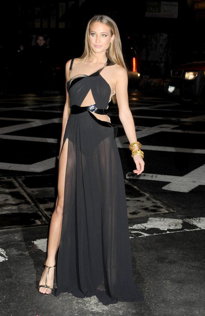 She had a sexy Angelina Jolie moment in the street in this strappy sheer gown.