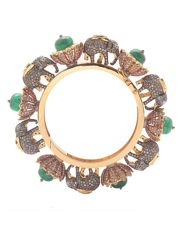 Makes a standout addition to your collection- gold and diamond bangle